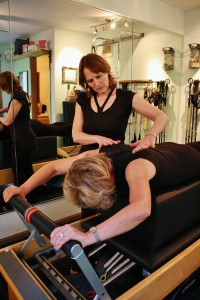 Inner strength pilates instructor teaching at Howling Dog Studio